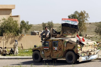 Victorious Iraqi soldiers drive through Tikrit