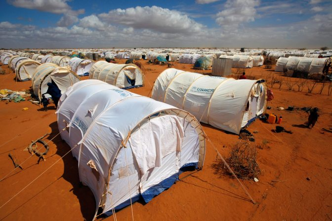 In this photo taken Friday, Aug. 5, 2011 tents are seen at the UNHCR's Ifo Extension camp outside Dadaab, eastern Kenya, 100 kilometers (62 miles) from the Somali border. The Dadaab refugee camp - the largest in the world - was built for 90,000 people. The current population is over 400,000 with thousands of new arrivals crammed into areas outside the refugee camp, waiting to be formally admitted. (AP Photo/Jerome Delay)